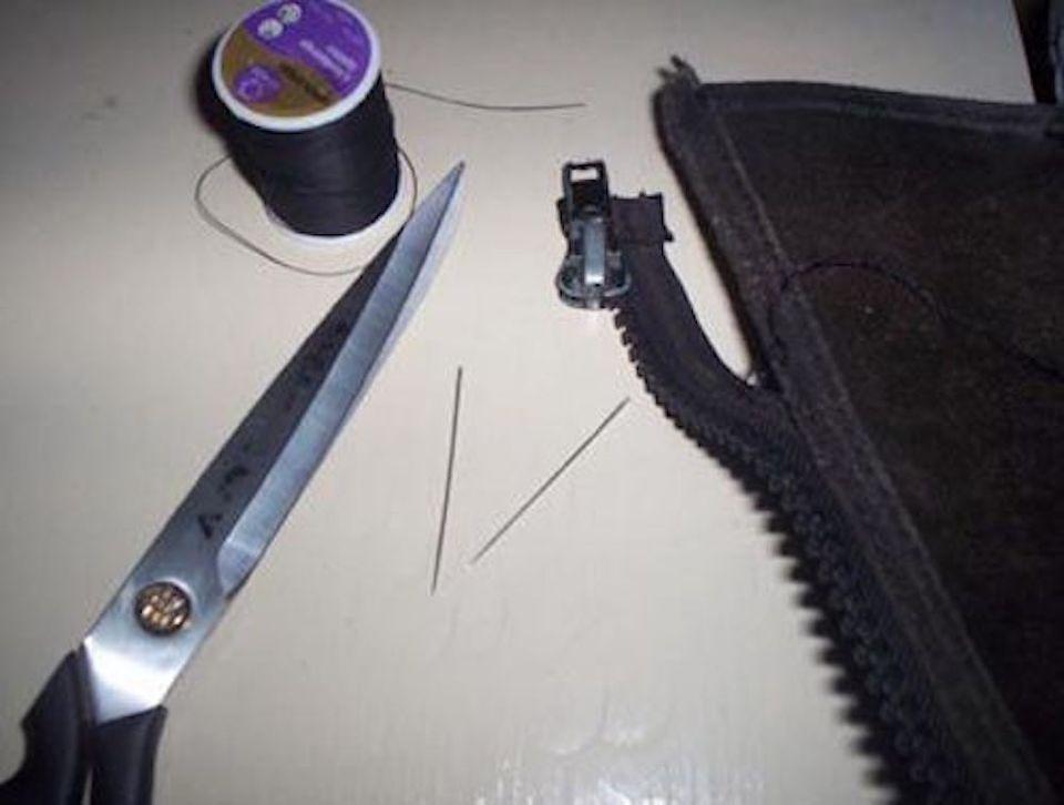 Thread, scissors, needles and a half chap that needs repair