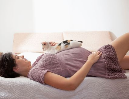 Photo of Pregnant Woman With Cat