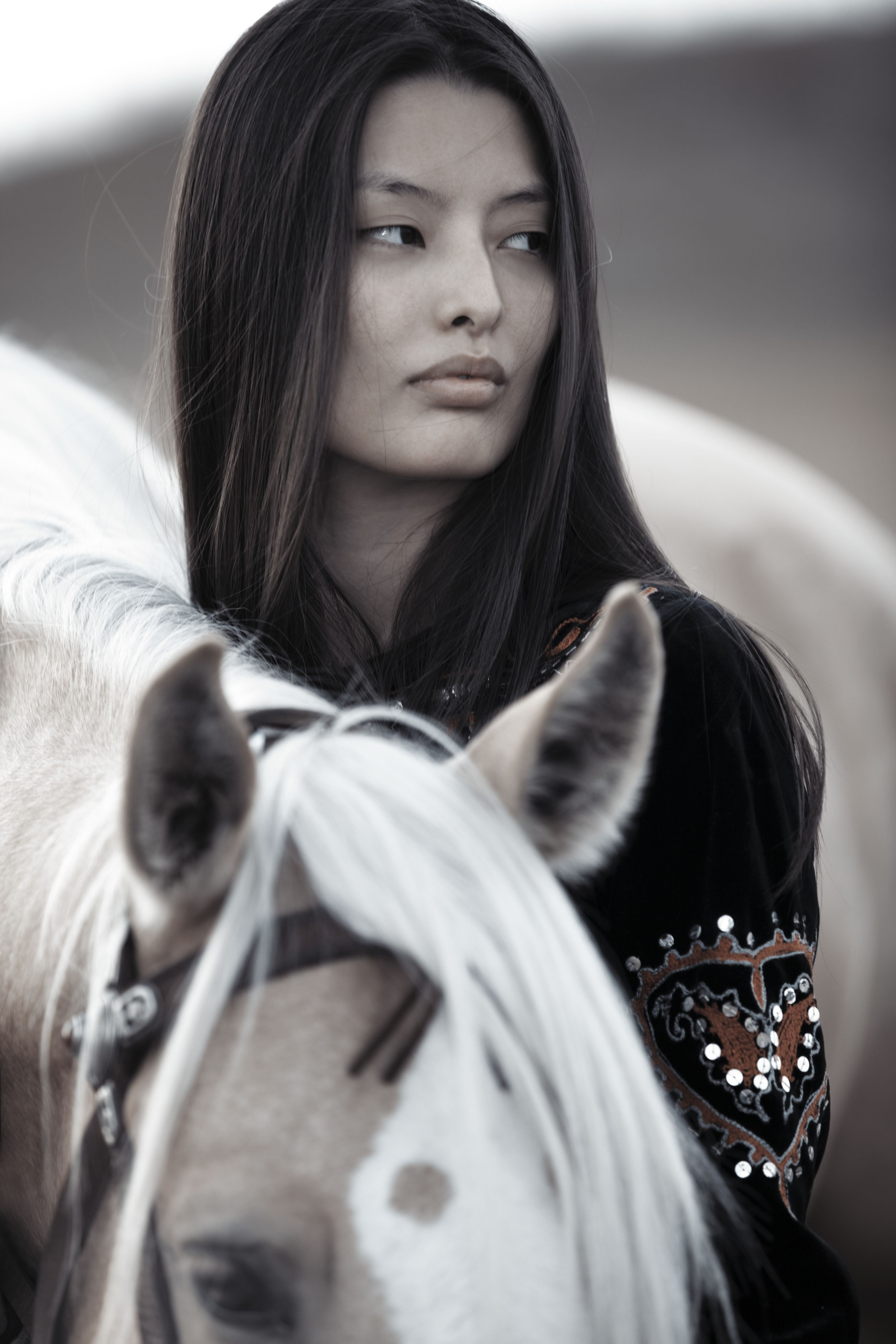 Brunette woman with horse