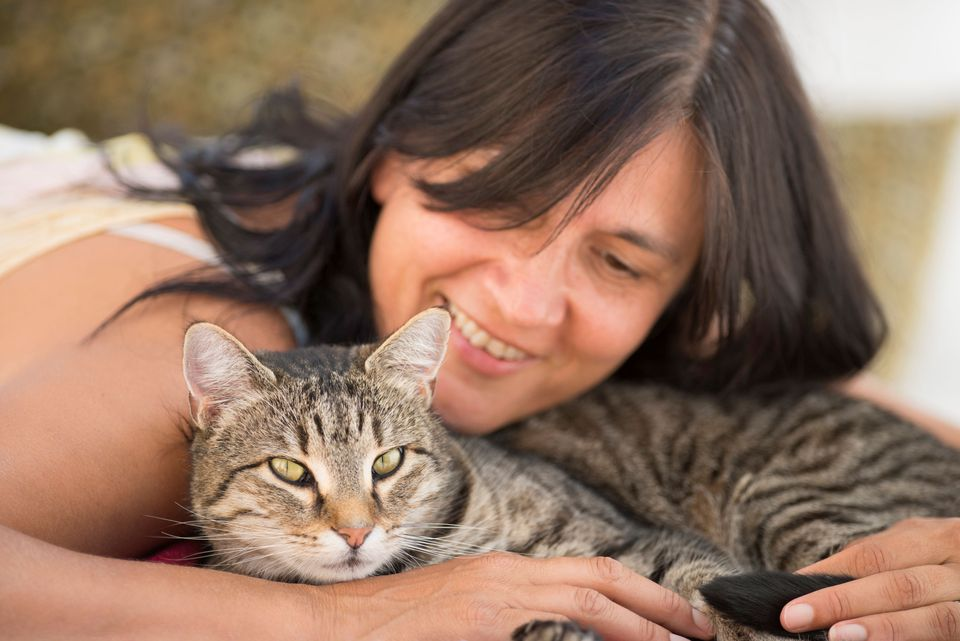 Photo of Woman Bonding With Cat
