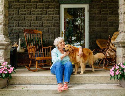 portrait of senior woman and golden retriever dog