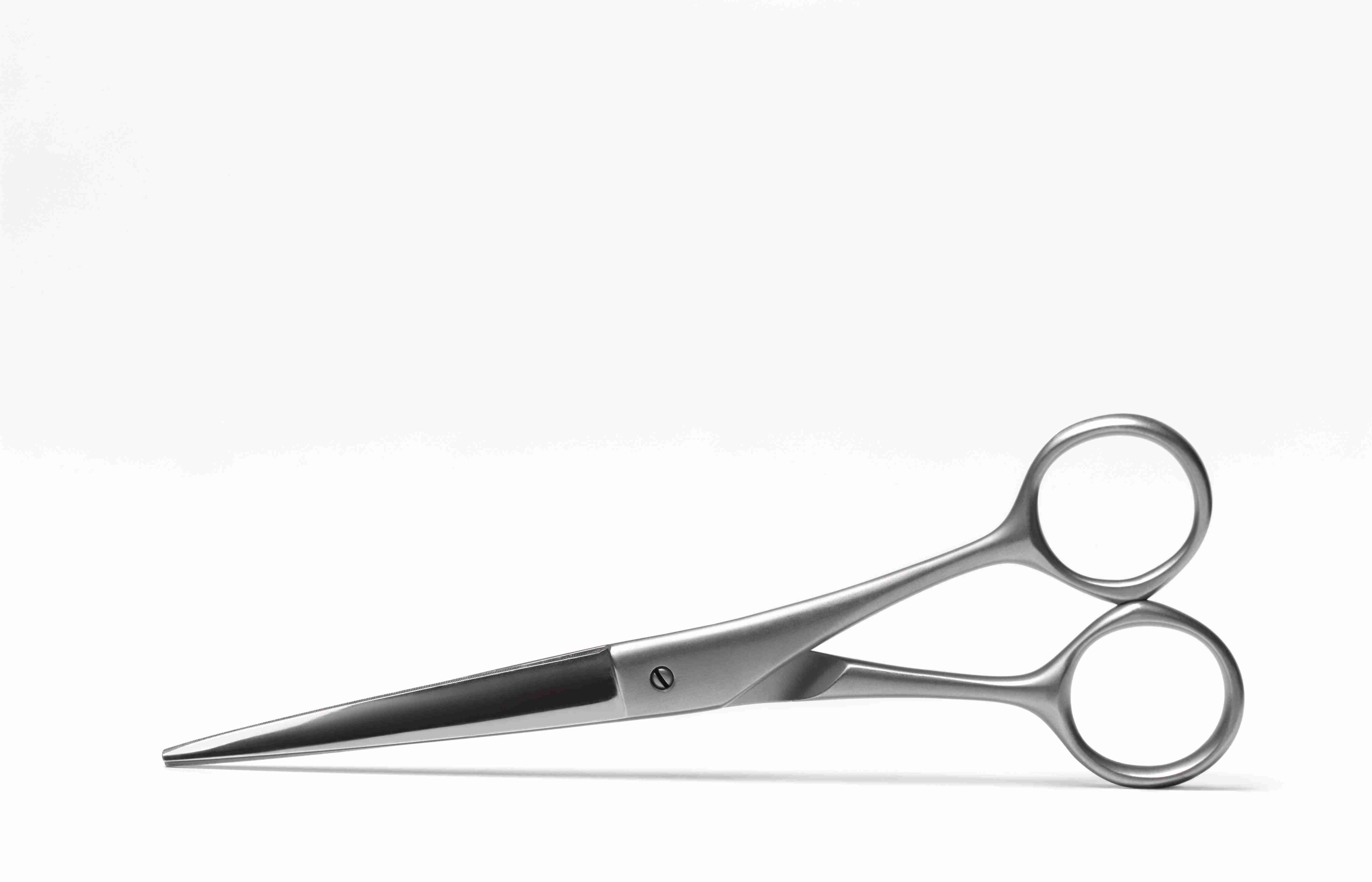 Scissors on white background