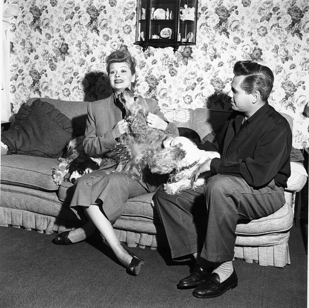 Actress Lucille Ball and her husband actor Desi Arnaz with their three Cocker Spaniel dogs circa 1950s.