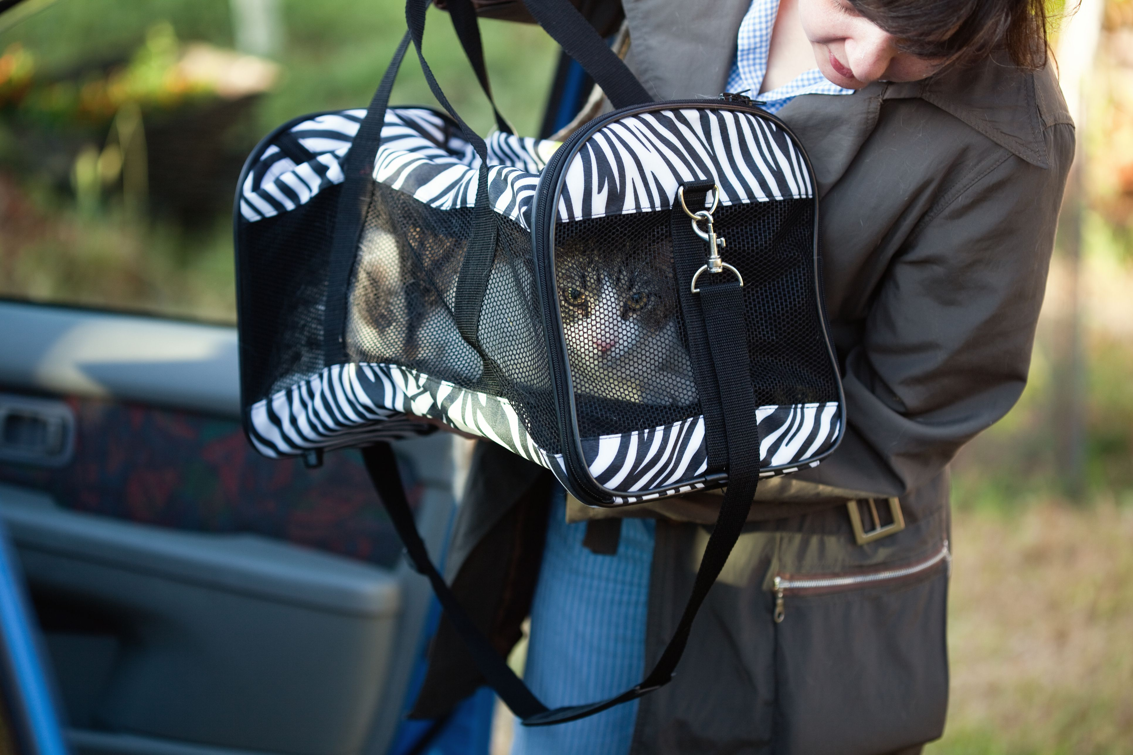 Woman with cat in pet carrier