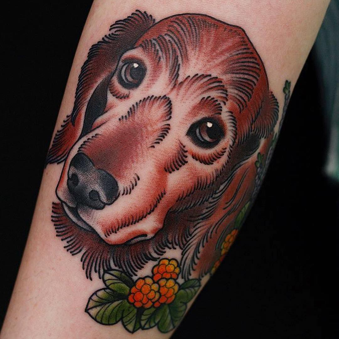 A colorful, American-style tattoo of a dog.