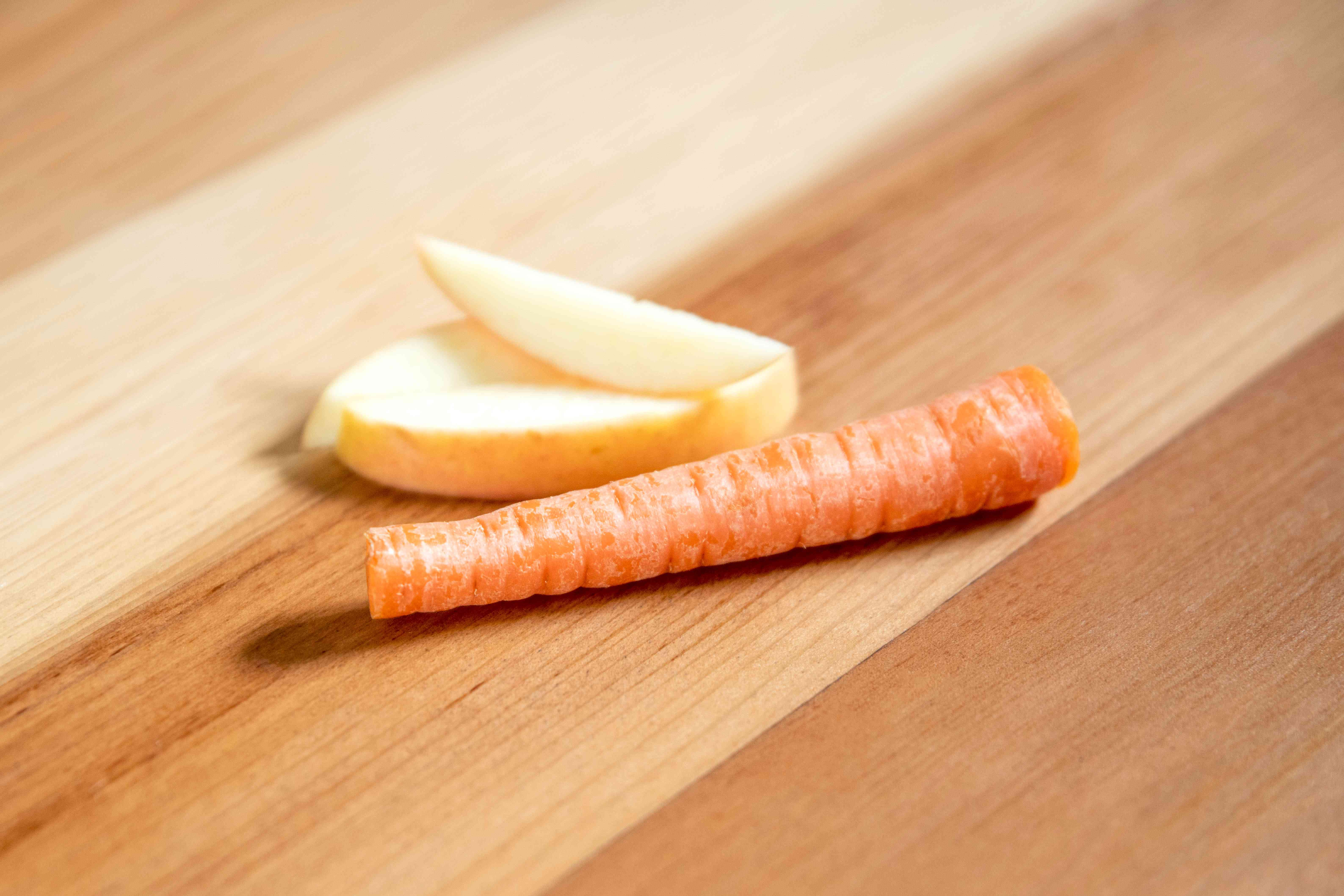 Apple slices and a carrot