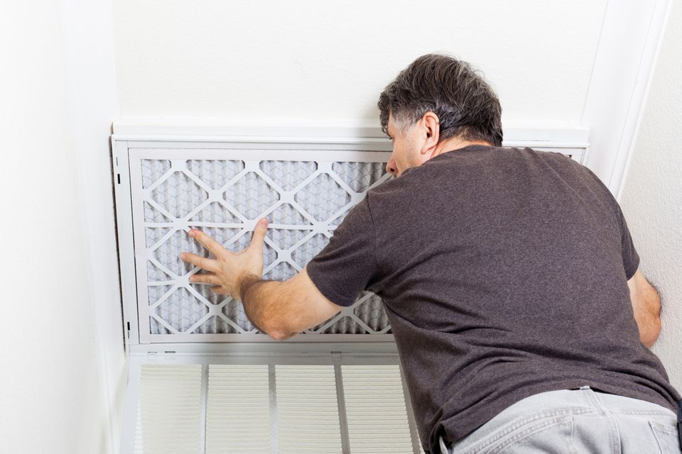 man installing air cleaner