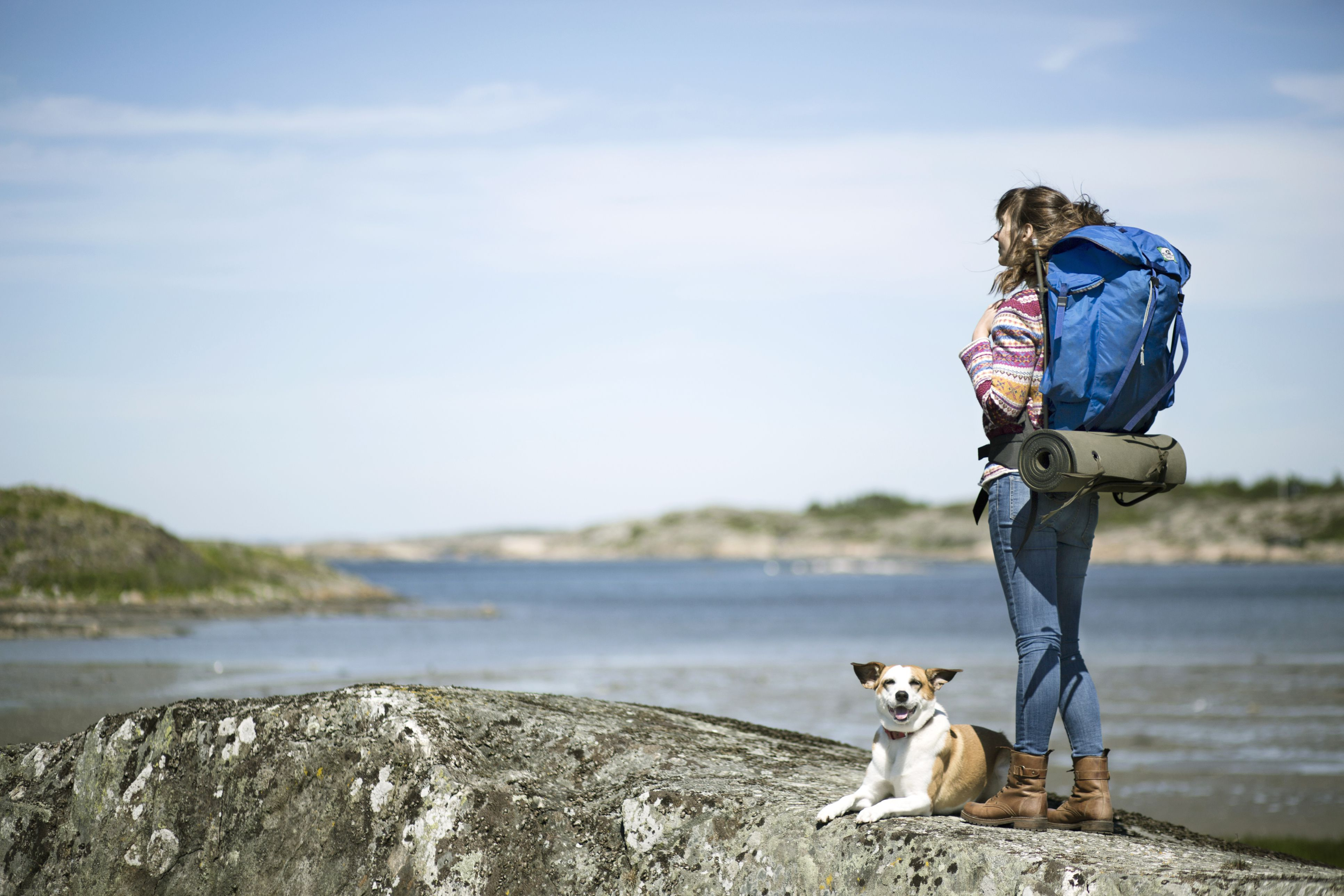 Woman hiking with her dog