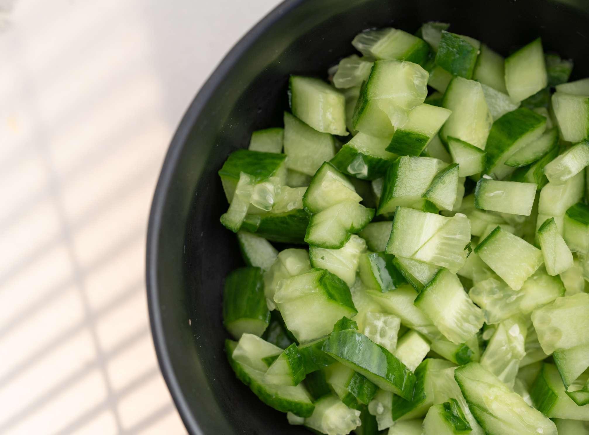 Bowl of freshly chopped cucumbers.