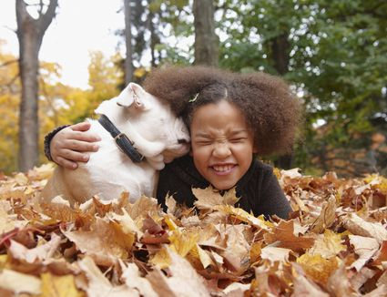 little girl with a small dog
