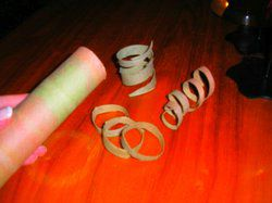 cut spirals from colored cardboard tube
