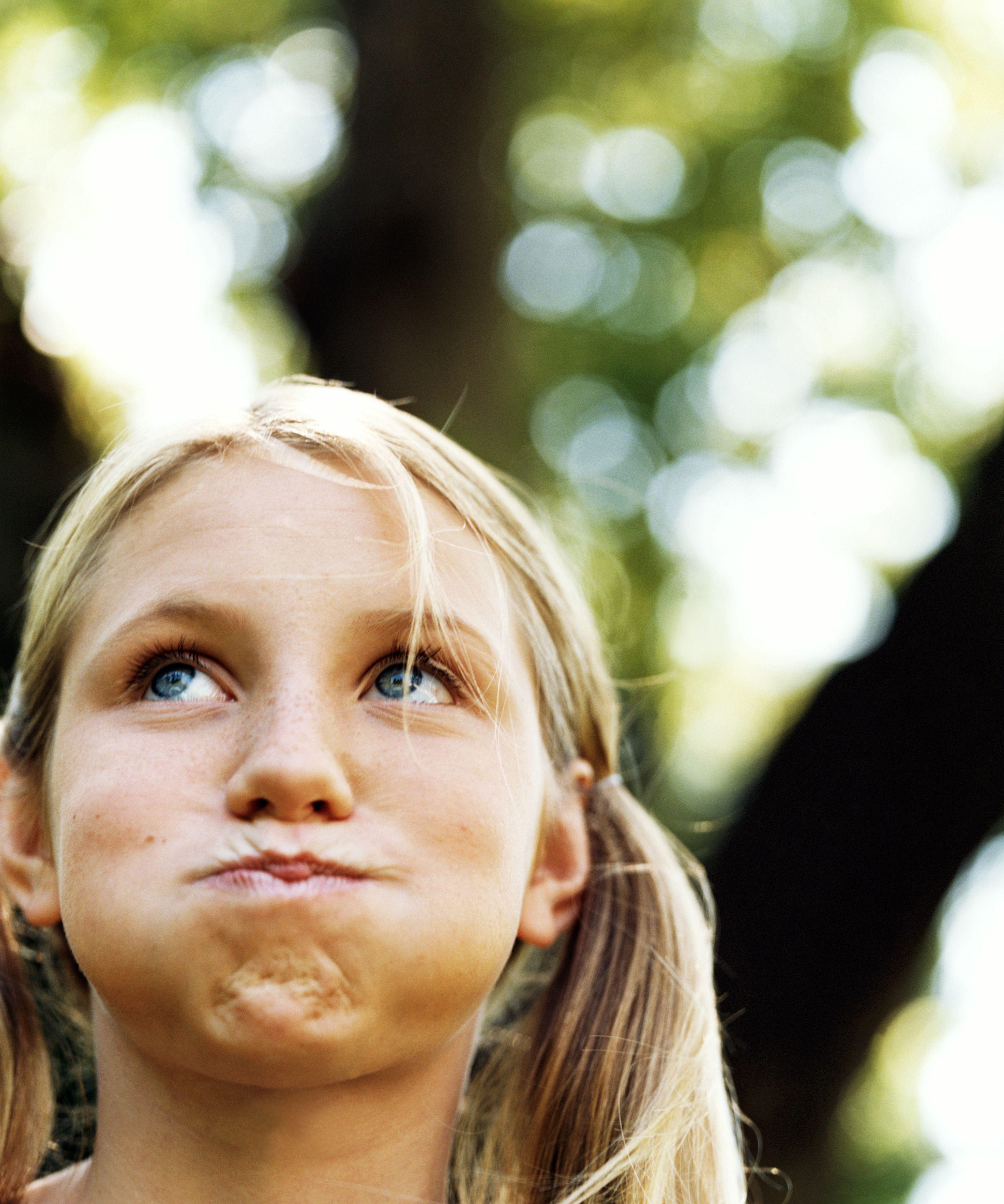 Teenage girl (13-15) holding breath