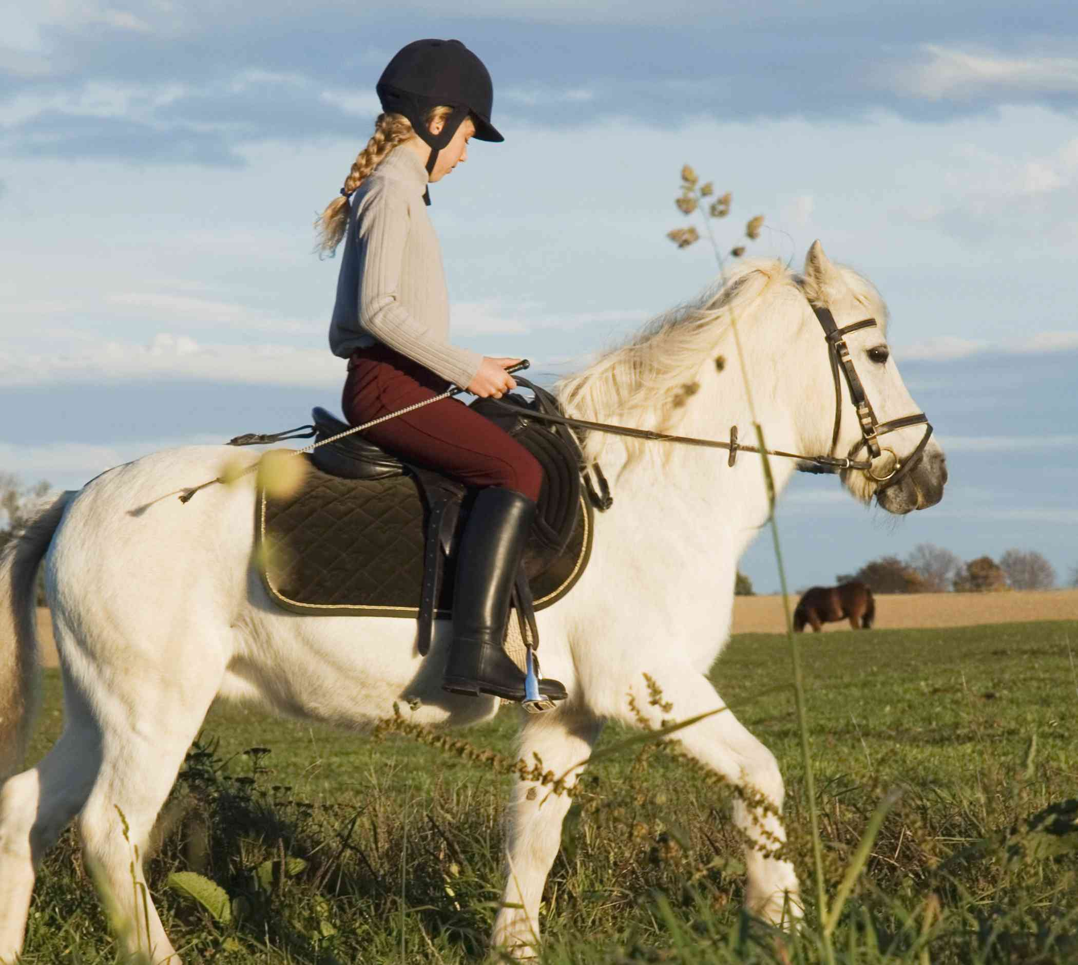 Girl riding white pony