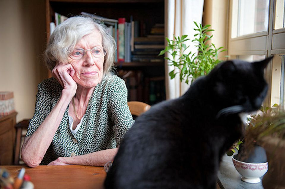 Photo of Elderly Woman With Black Cat