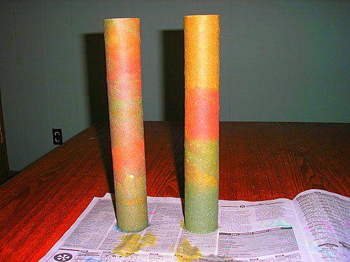Two multi-colored cardboard rolls