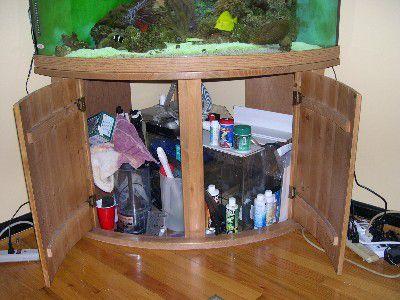 Disorganized aquarium cabinet