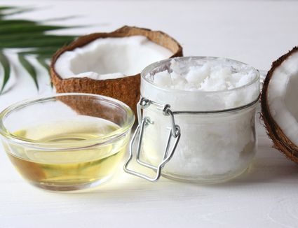 coconut oil and coconuts, palm branches close up