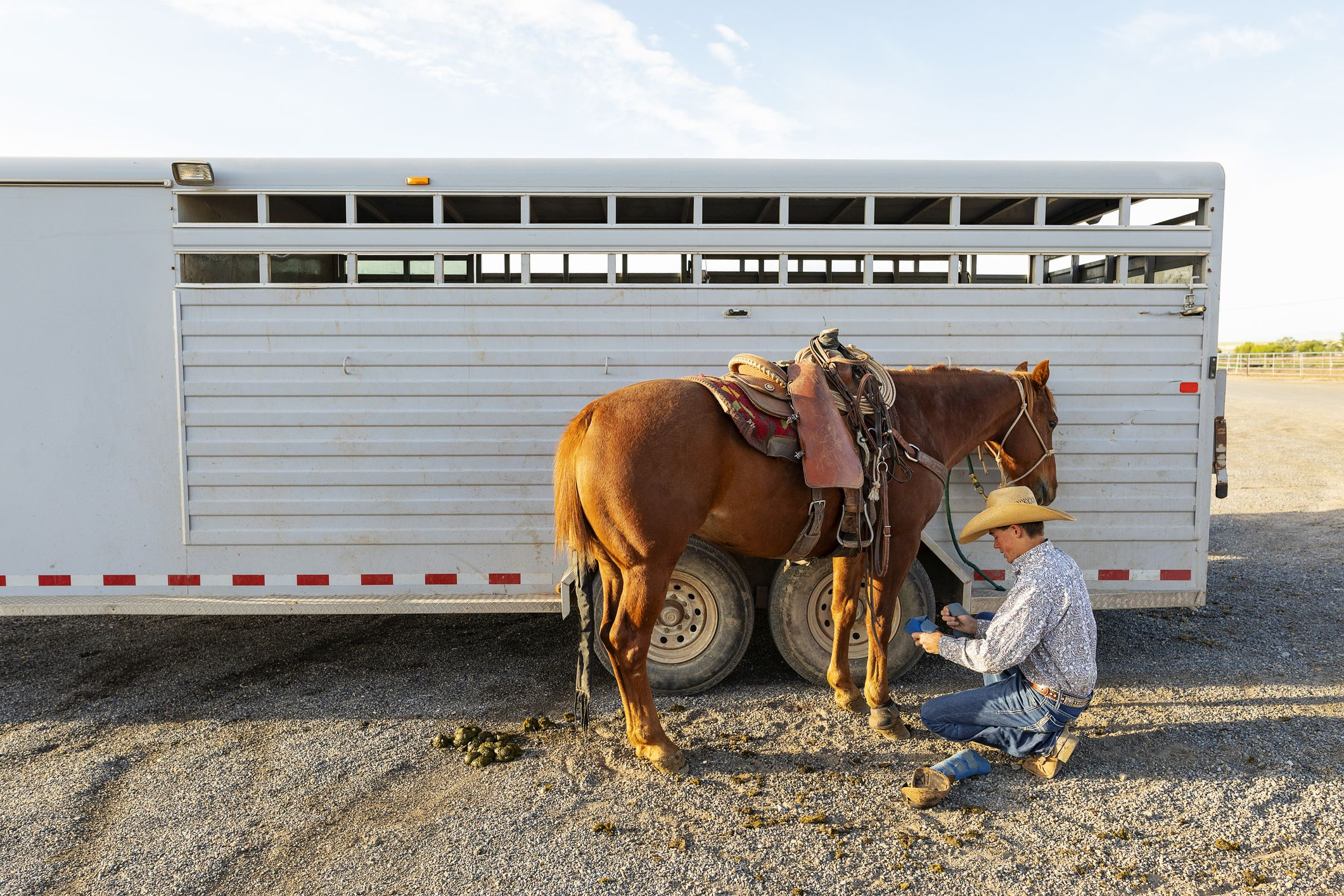 Aluminum trailer behind horse and owner