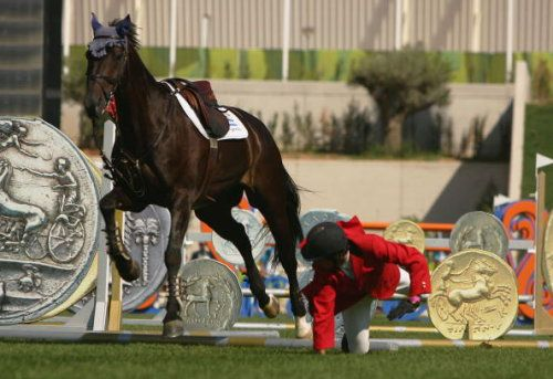 Olympic rider falling from horse.