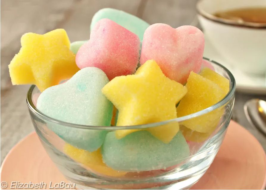 Homemade sugar cubes in heart and star shapes.