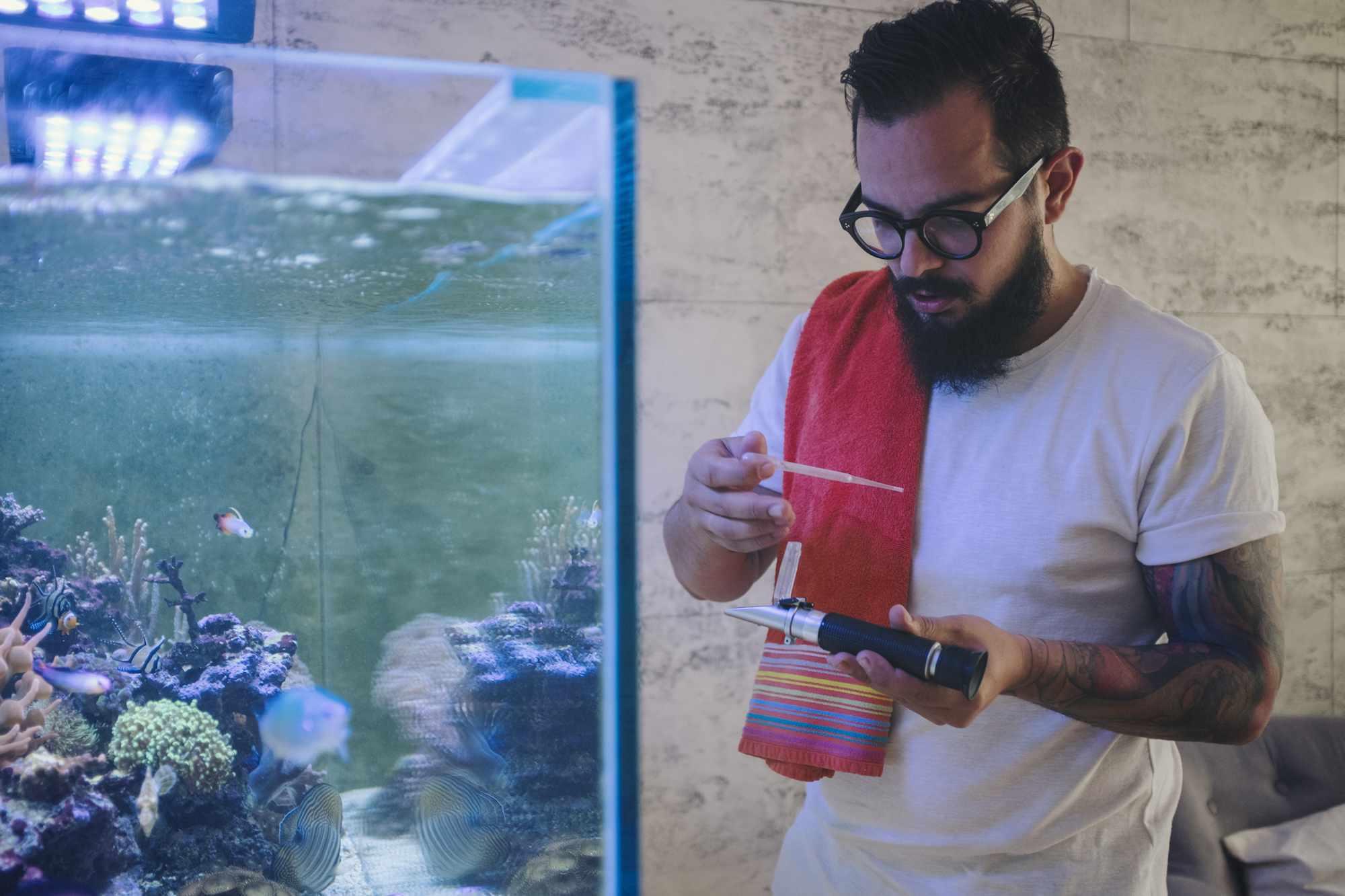 Man testing fish tank
