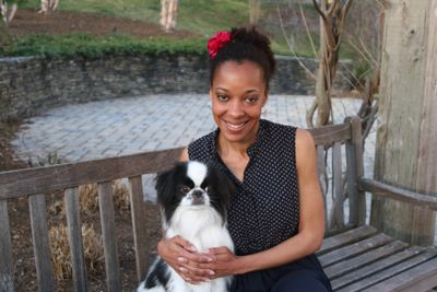 Dr. Nia Perkins with Japanese Chin Miles Davis
