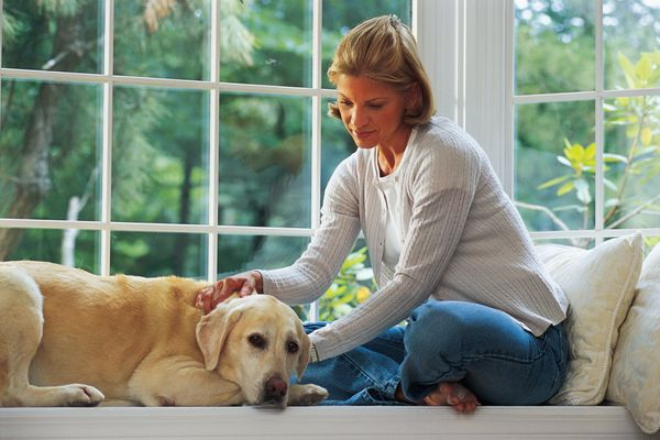 Woman at home with dog