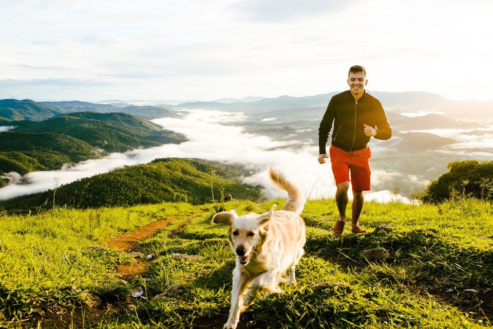 man chasing after dog