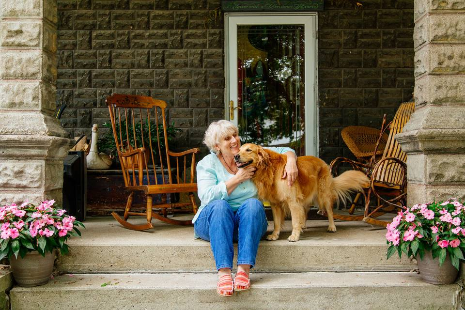 portrait of senior woman and golden retriever dog