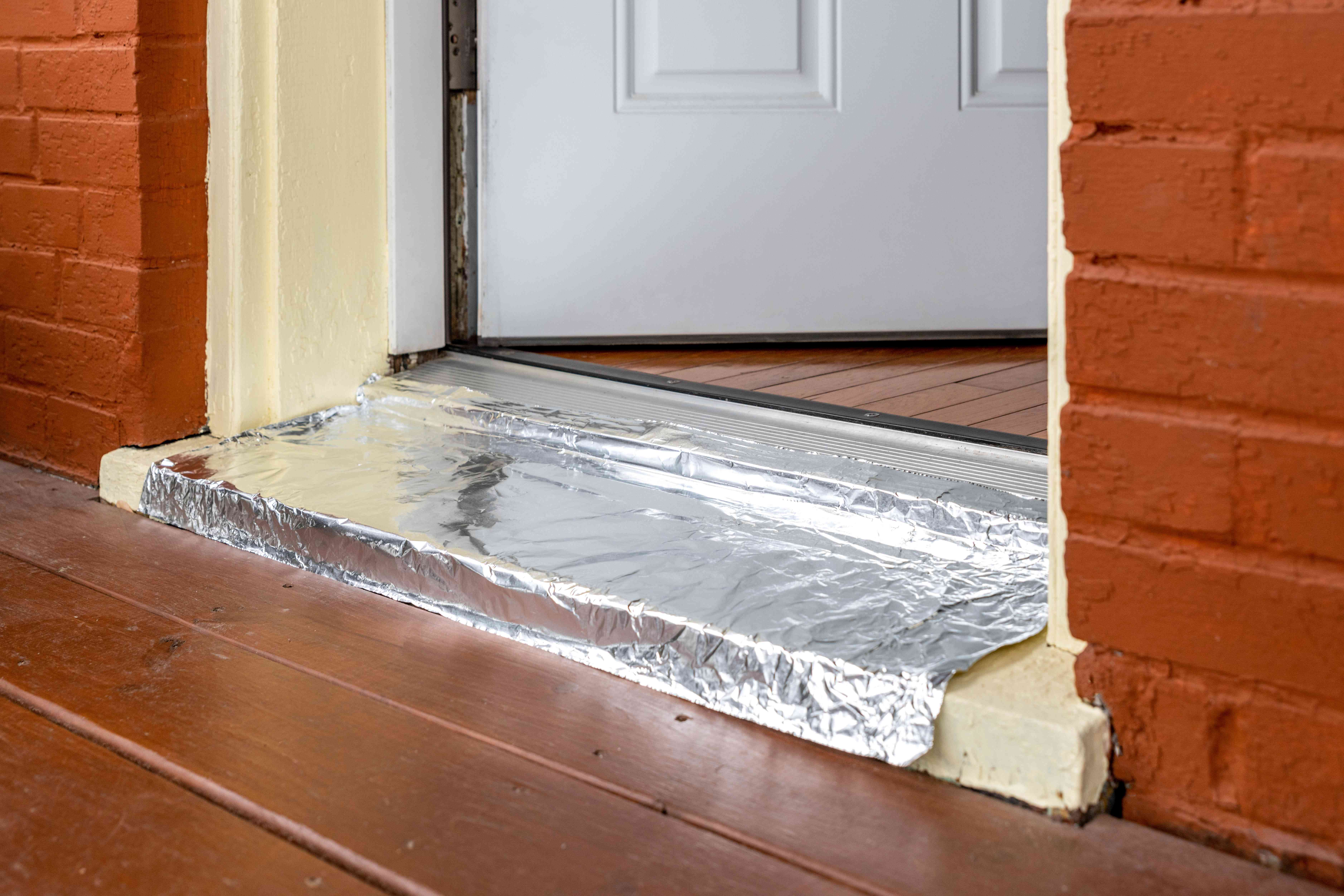 Front doorway covered in aluminum to prevent cats from escaping