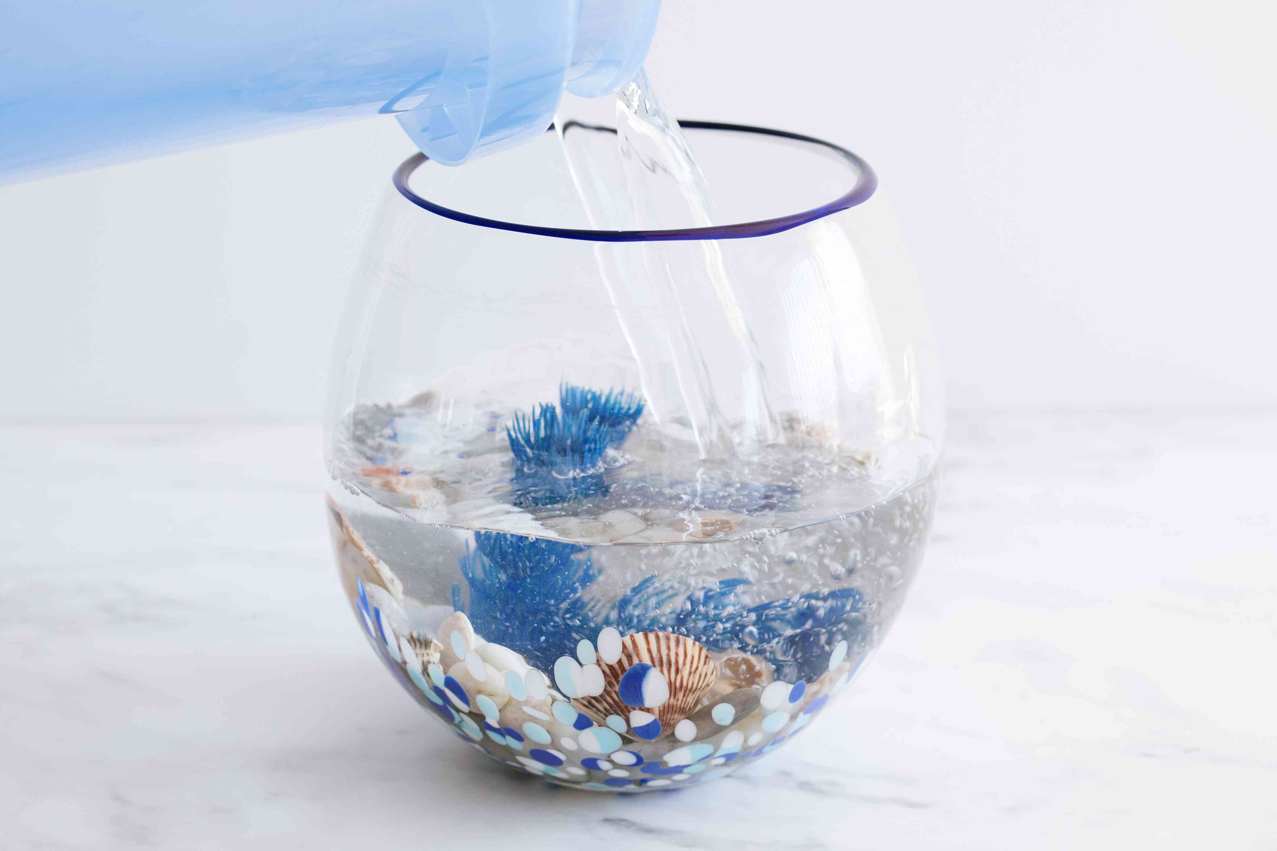Fishbowl cleaned and reassembled with decorations and prepared water