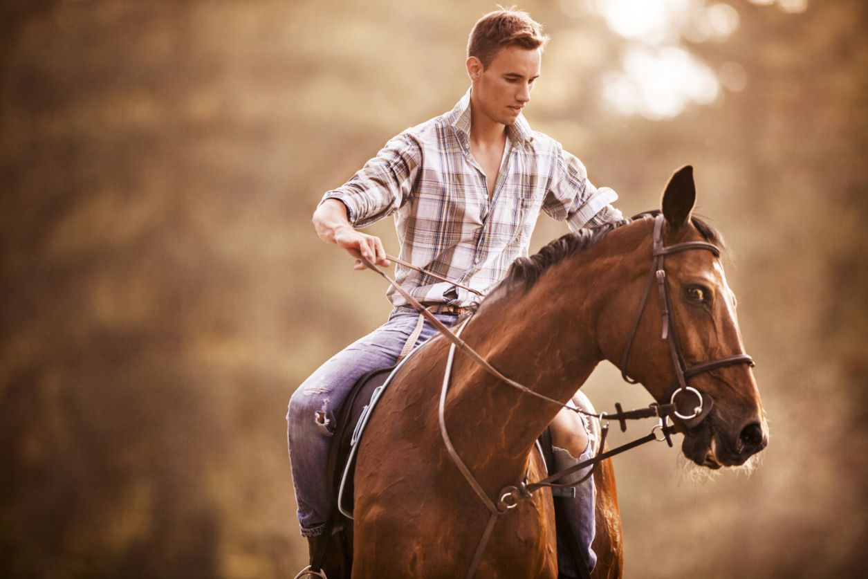 Man struggling to control horse