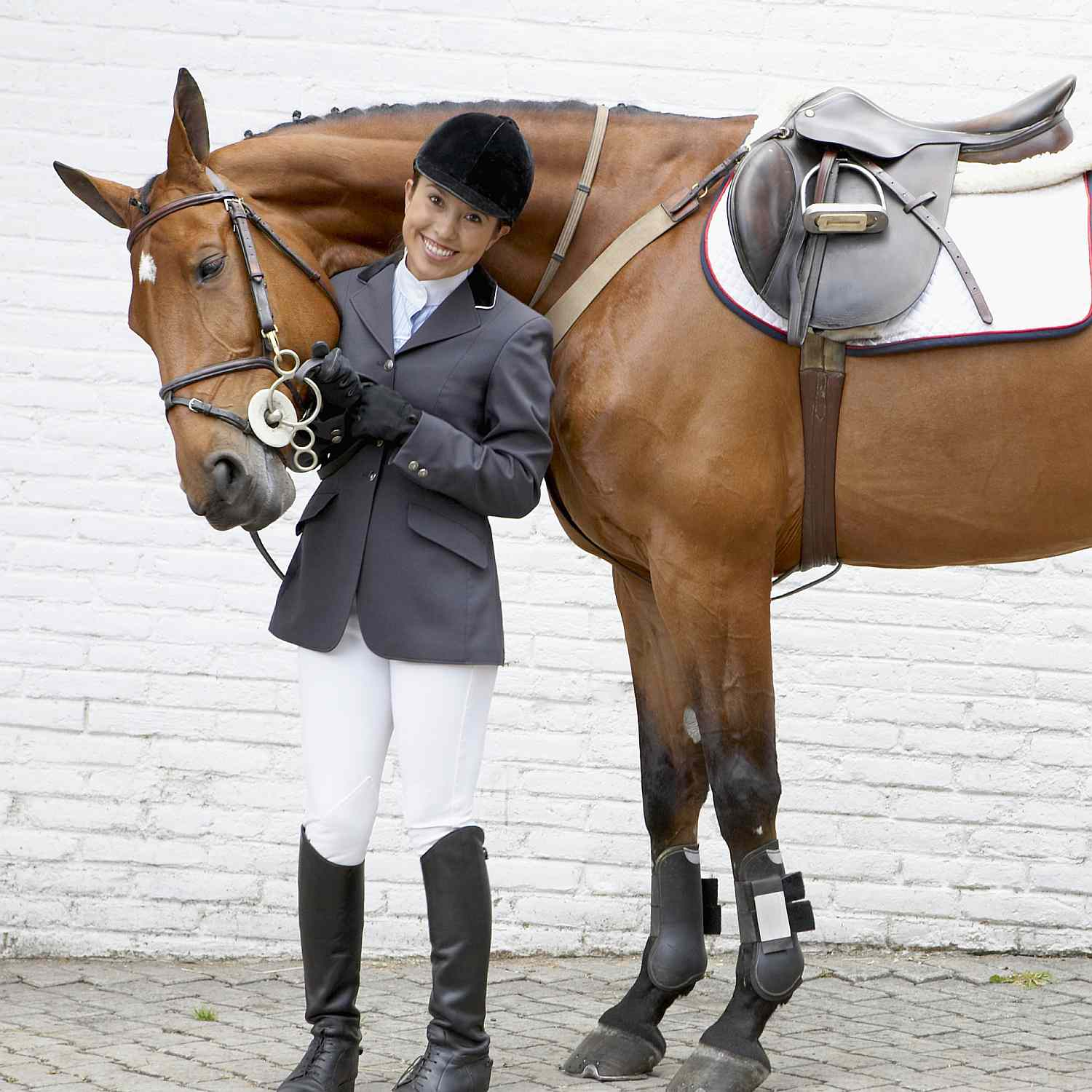 Horsewoman Standing Beside Full Tacked up Horse